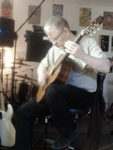 Bill jamming on acoustic guitar